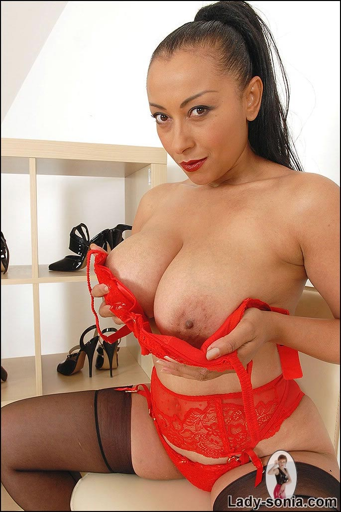 Danica Collins taking her red lingerie slowly