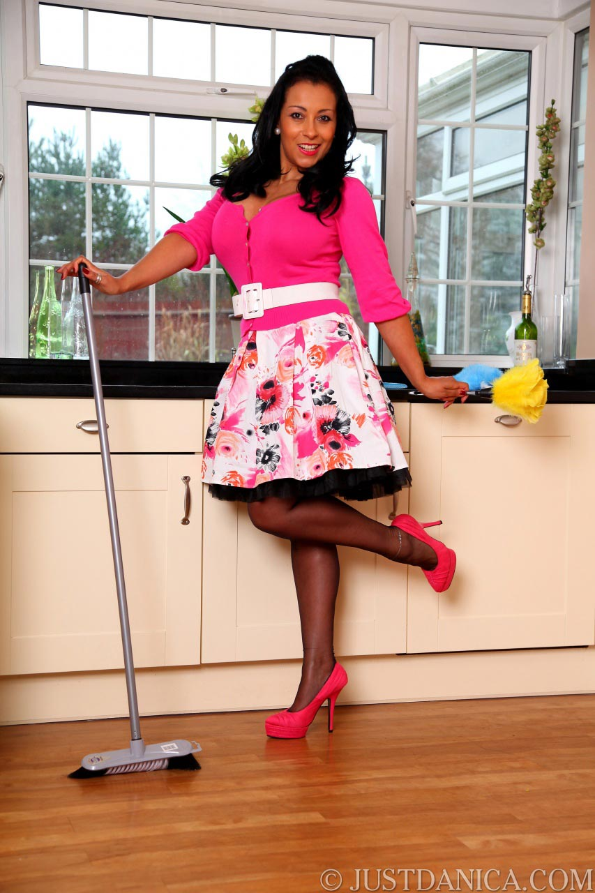 Mature lady Danica Collins looks very attractive in that pink maid  uniform
