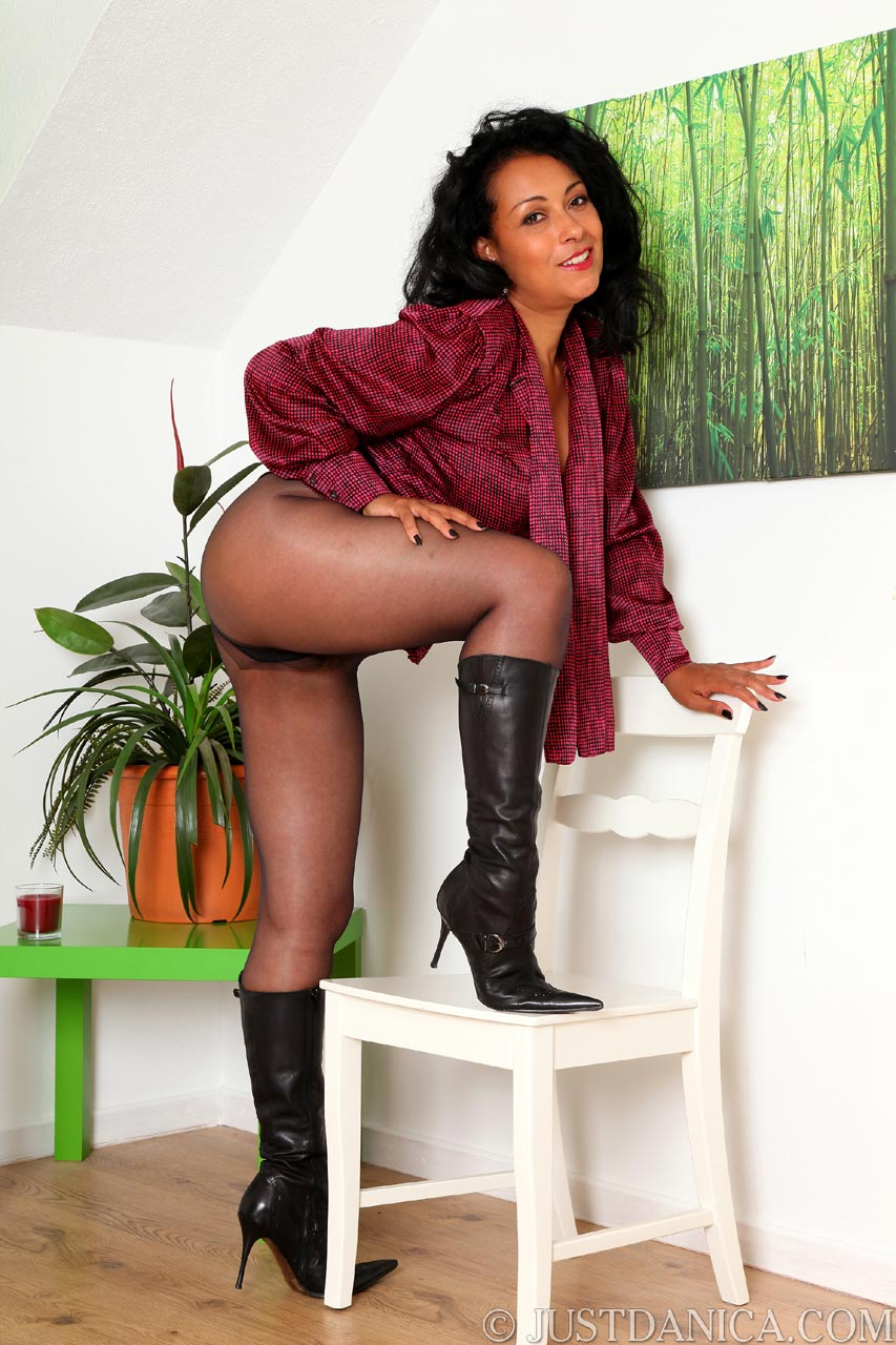 Leather high heel boots look exceptionally sexy when being worn by elegant MILF lady