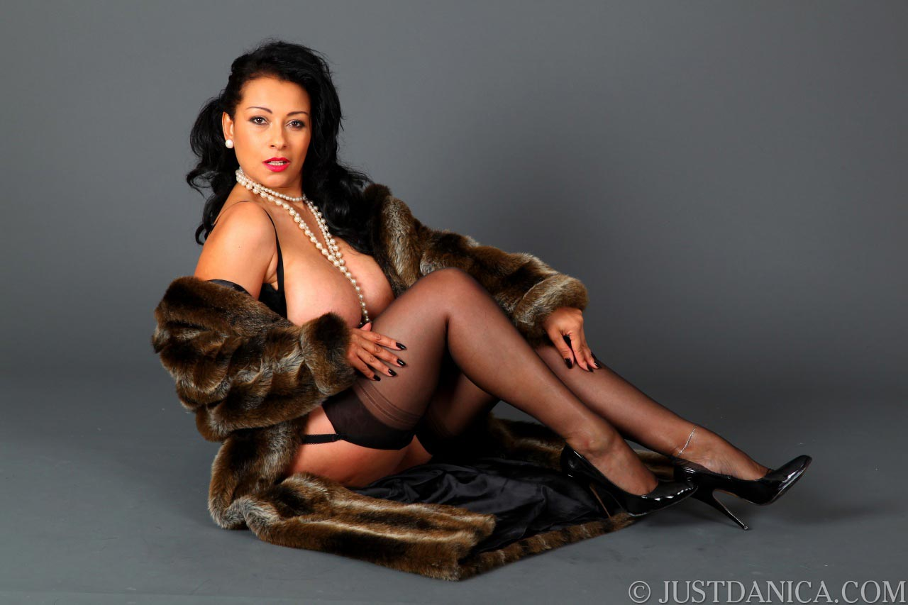 Danica Collins is incredibly sexy when wearing fur, stockings and high heels