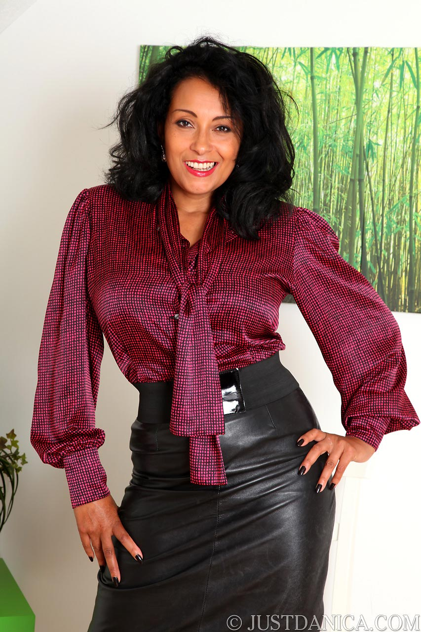 Danica Collins is dressed like a secretary: MILF is wearing leather skirt and red blouse