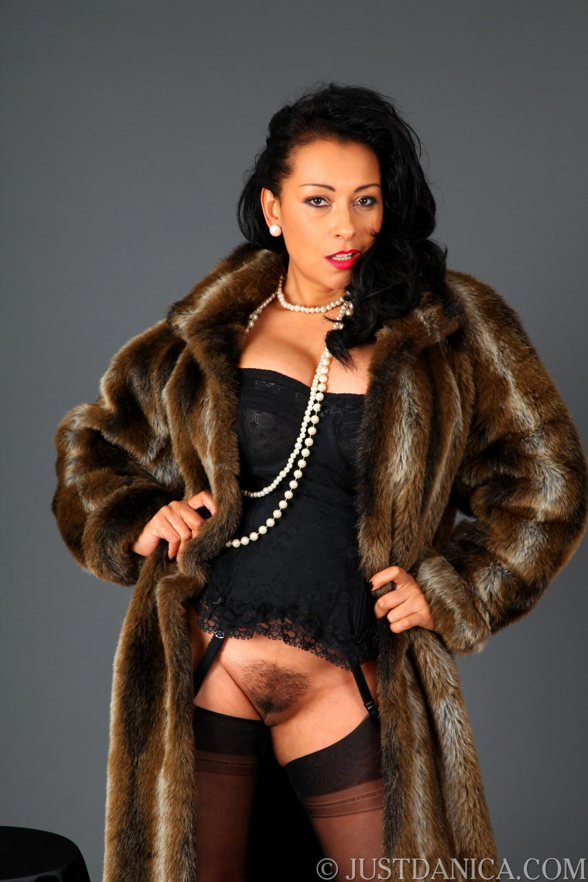 Classy MILF Danica posing in fur but wearing no knickers under