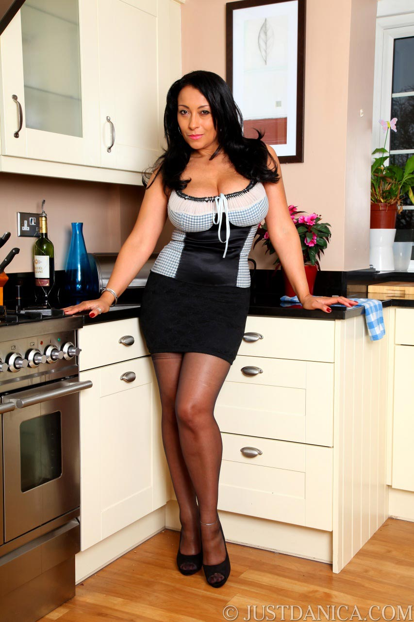 Danica Collins starts her erotic posing as being a shy but slutty housewife