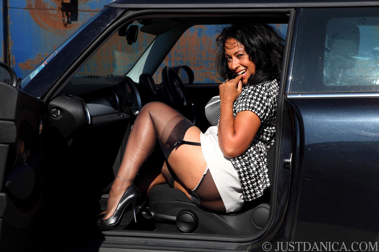 Danica Collins is trying to seduce you by doing kinky flashing with her skirt