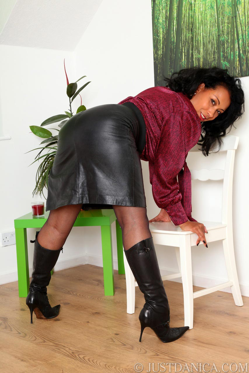 Danica Collins looks extremely sexy when dressed in leather skirt and high heel boots