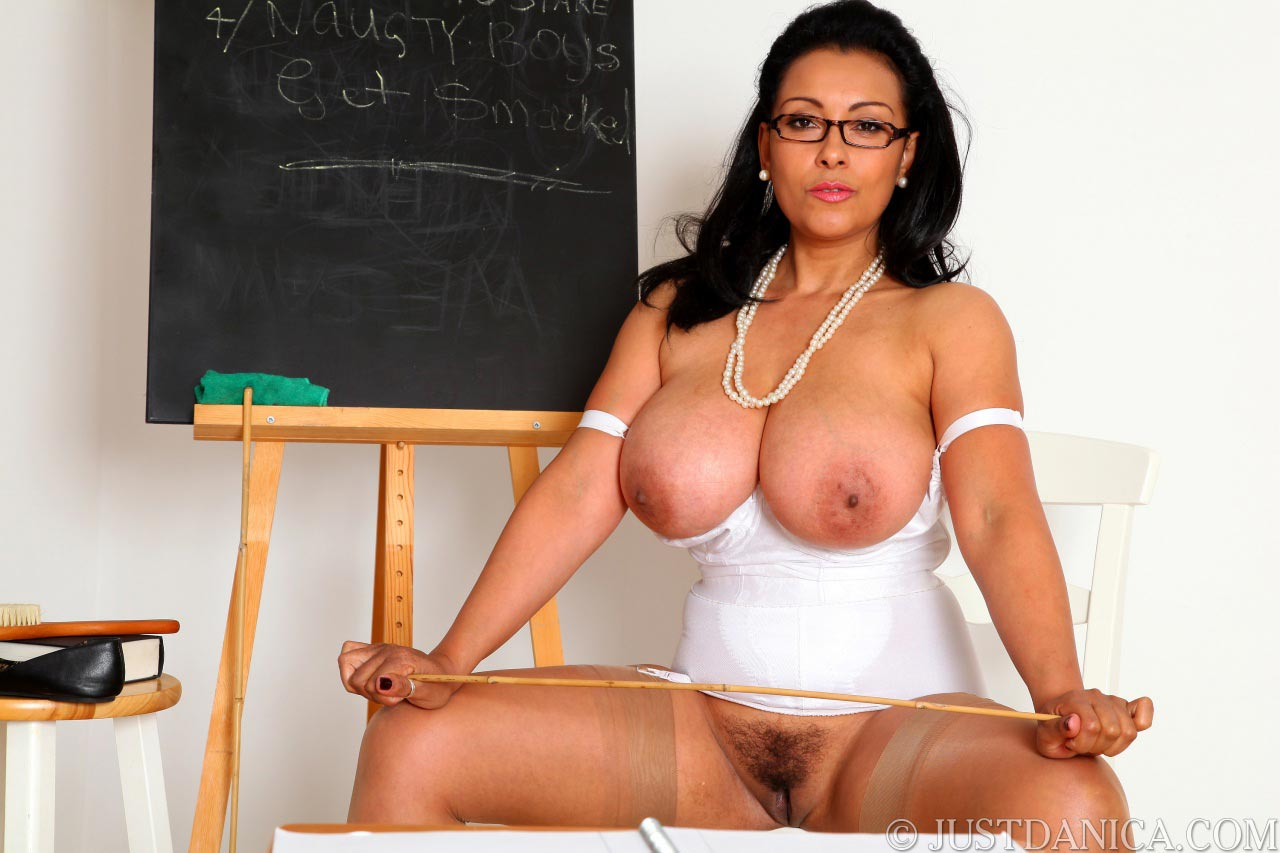 Sit back, relax and enjoy MILF teacher spreading legs and exposing her pussy