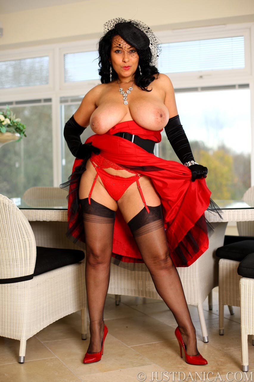 Busty MILF Danica is flashing with her skirt, showing you what's underneath