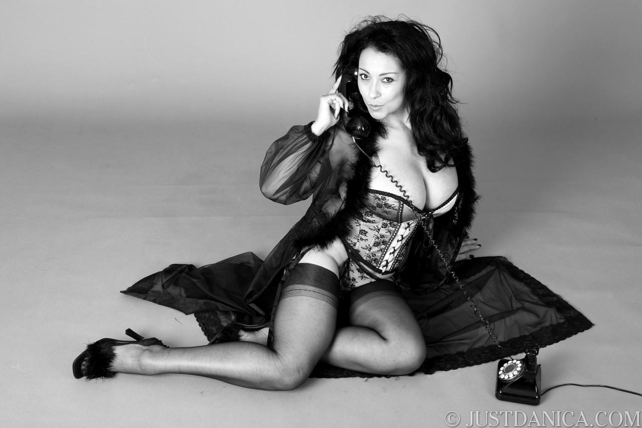 Classy black and white picture of Danica Collins posing in pin-up styke