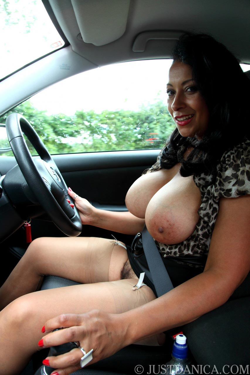 Stop staring at the exposed tits of a busty MILF driver behind the wheel