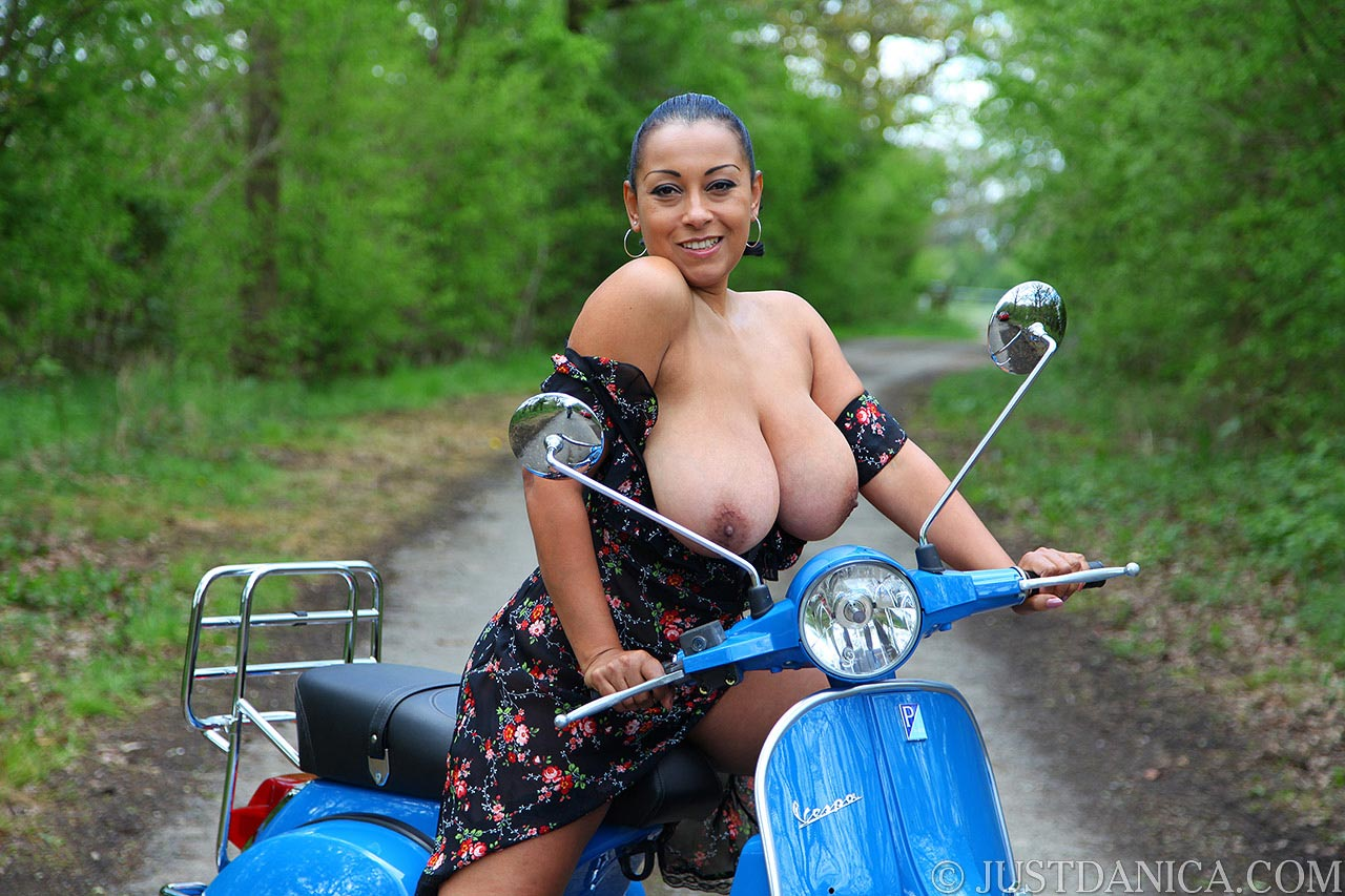 MILF Danica thinks it is funny - to have her tits trempbing out of the dress during scooter ride