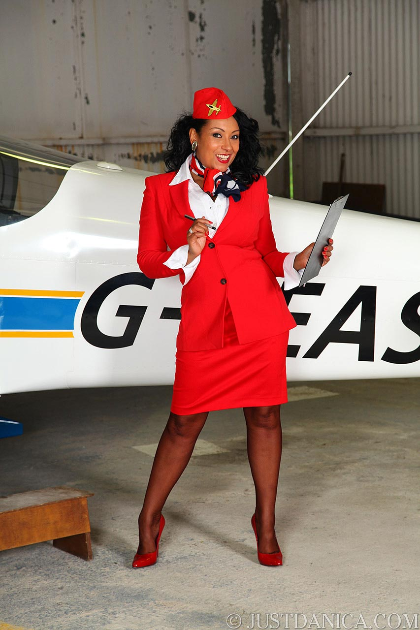 Join sexy stewardess for a kinky flight: do you like the red uniform she is wearing?