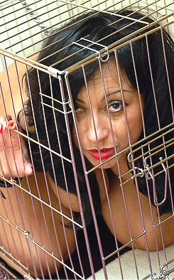 Caged MILF is nude and helpless