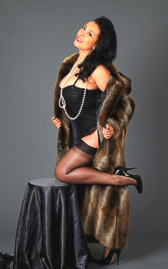 Danica Collins posing in luxurious fur coat