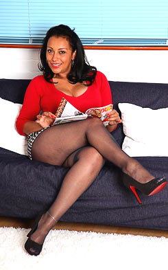 Danica posing in heels and black pantyhose