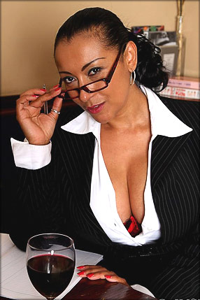 MILF Danica Collins looks sexy in business suit