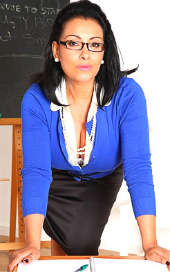 Teacher Danica Collins is posing in her blouse unbuttoned