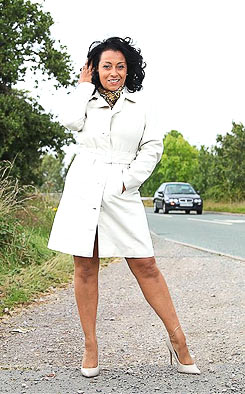 Leggy MILF posing in high heels and coat