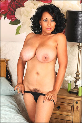 Undressed MILF in bedroom
