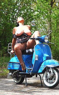 Woman is riding scooter pantieless