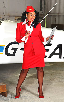 Stewardess in a uniform is happy to see you